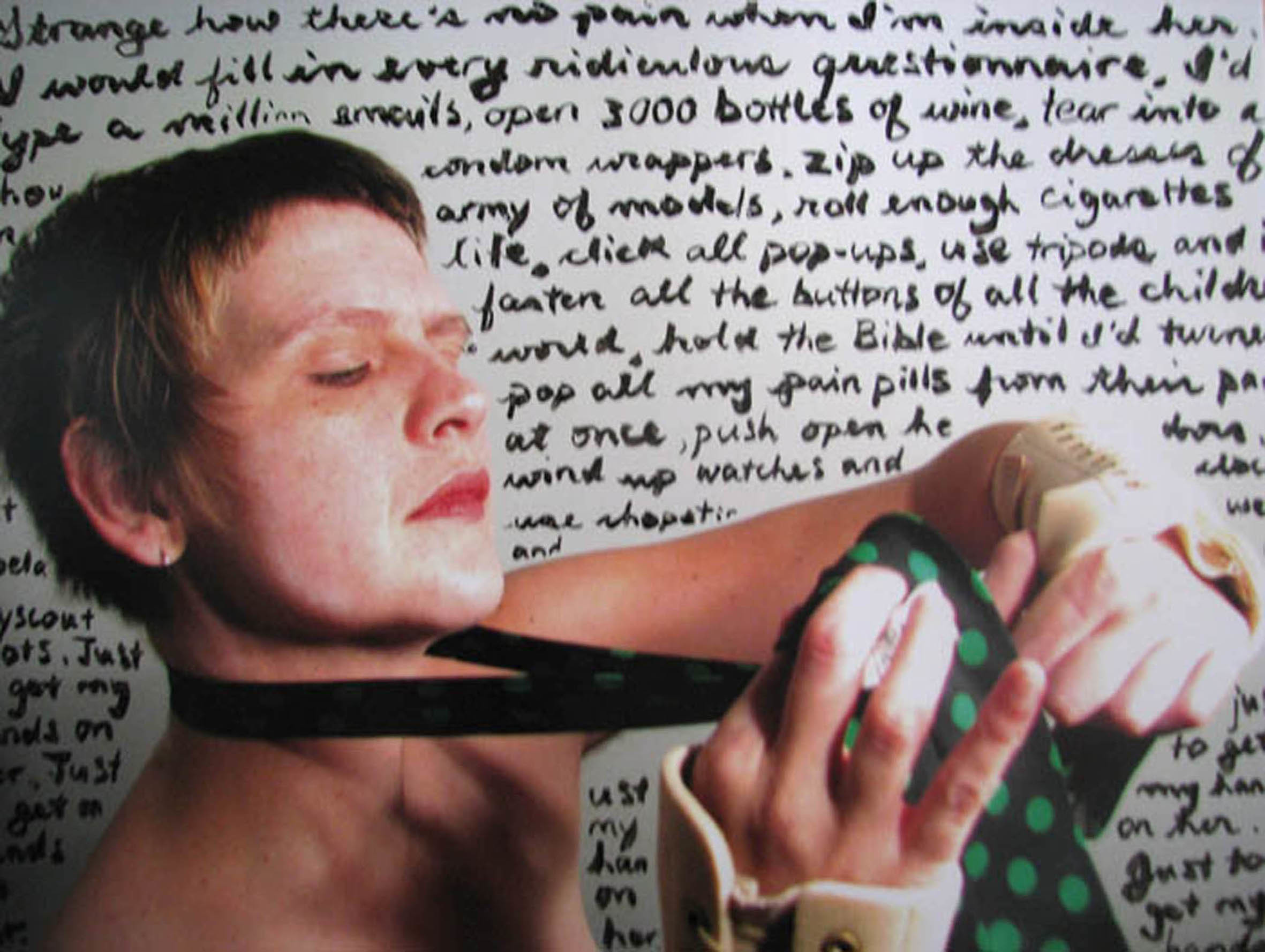 A photograph of multi-disciplinary artist Sandra Alland. They are wearing a tie and wrist supports and is against a backdrop of handwritten words.